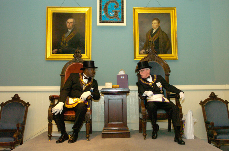 James R. Fitzgerald Jr., left, Grand Master of the Most Worshipful Prince Hall Grand Lodge Free and Accepted Masons of Delaware, and Ronald W. Conaway, right, Grand Master of the Most Worshipful Grand Lodge of Ancient Free and Accepted Masons of Delaware, talk before a ceremony of recognition at the Grand Opera House in Wilmington, Del., in this Sept. 16 file photo.