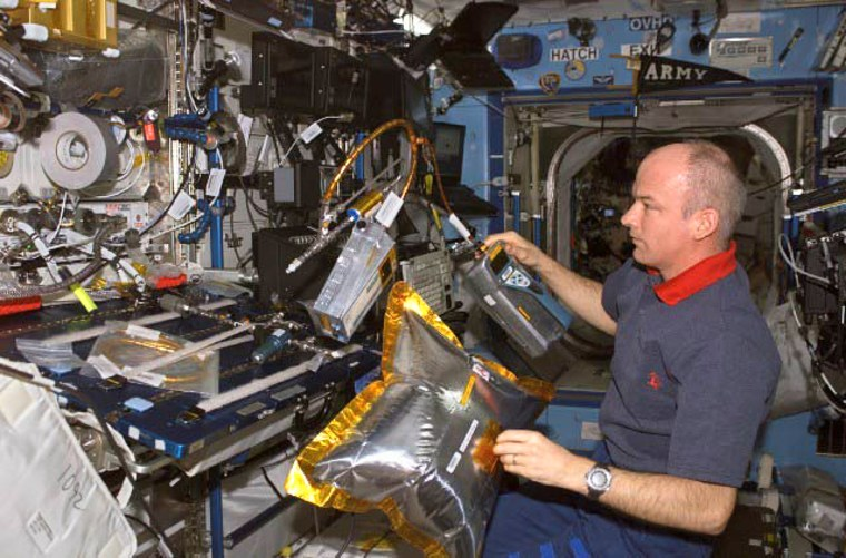 Astronaut Jeffrey Williams, Expedition 13 NASA space station science officer and flight engineer, works with the dust and aerosol measurement feasibility test (DAFT) in the Destiny laboratory of the International Space Station.