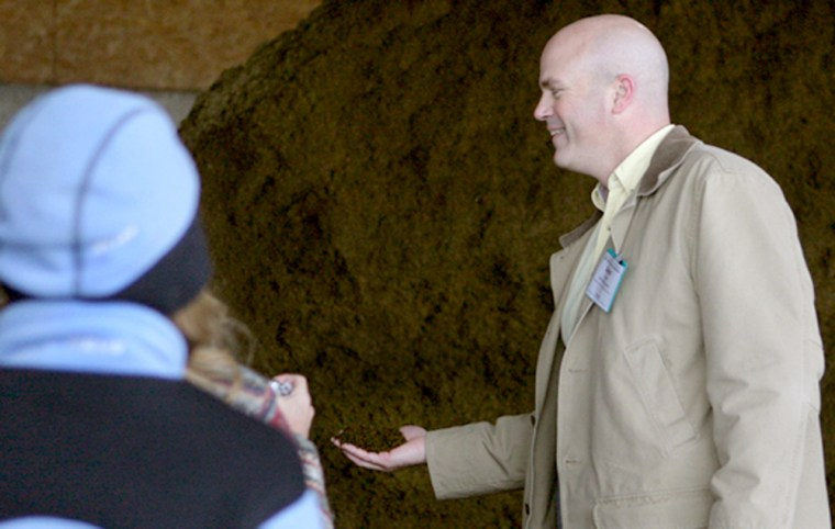 David Dunn, head Central Vermont Public Service's Cow Power program, holds a handful of manure solids left over after methane was extracted from raw manure. The process leaves a dry manure removed of pathogens and odor that is used as bedding for cows.
