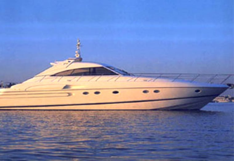 The three-cabin , a Princess V65, is based in Mallorca. The cockpit has a sliding roof for a wind-in-your-hair ride, and the luxurious interior features cream-colored couches and glass tables.