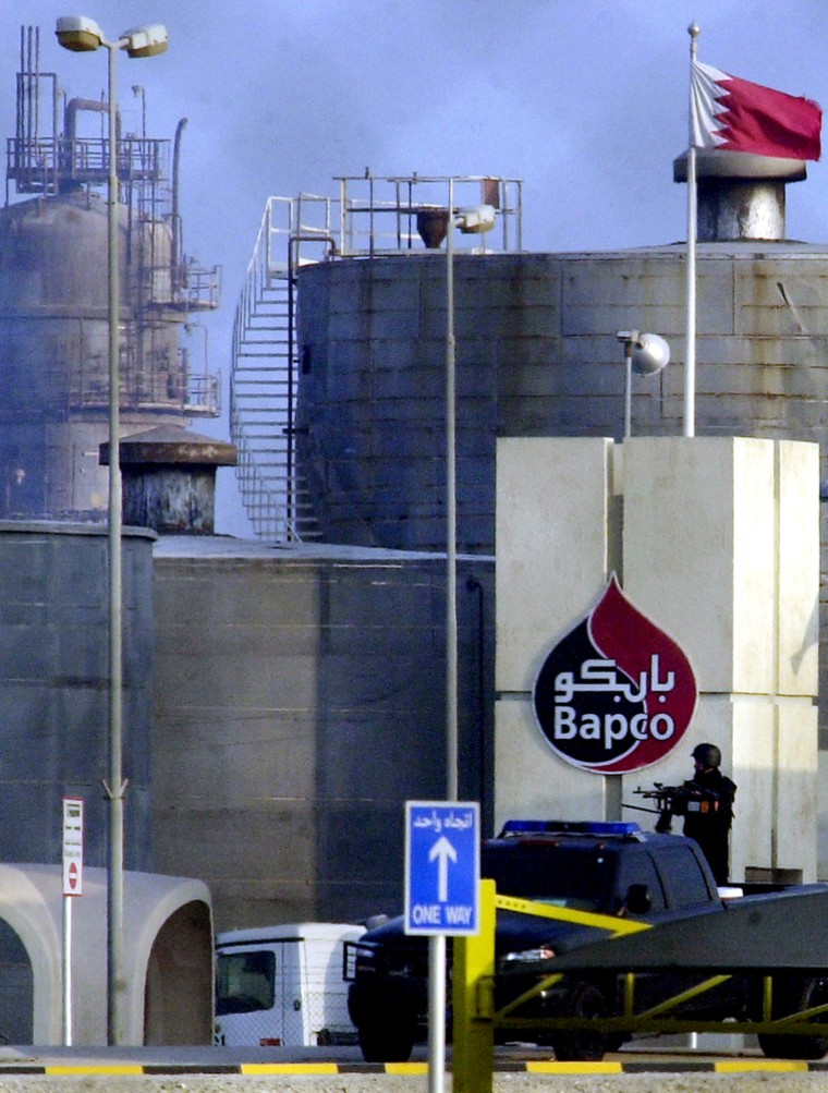 A Bahraini military commando stands guardon Thursday at the gates of an oil refinery in Sitra, Bahrain, belonging to the national petroleum company, Bapco.