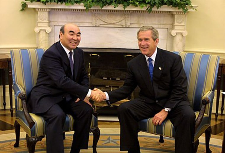 President Bush shakes hands with Kyrgyzstan President Aska Akaev in the White House on Sept. 23, 2002.