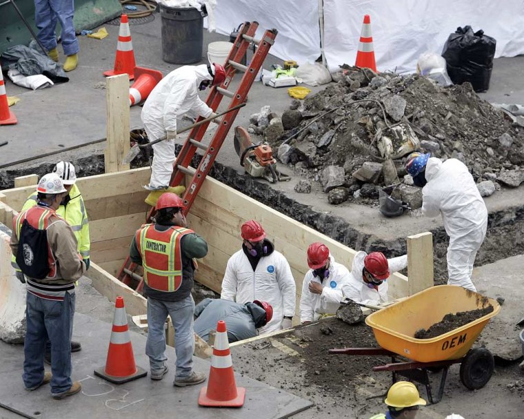 Workers search the area where human remains were found at the site of the World Trade Center in New York City.