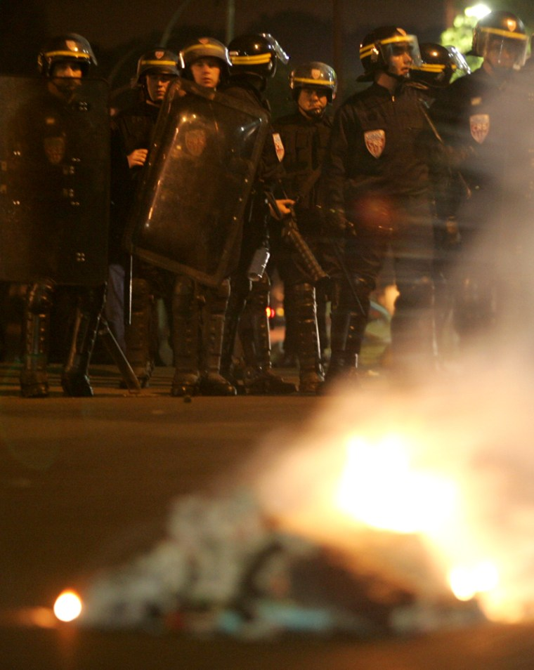 French riot police secure the northeastern Paris suburb of Montfermeil on Saturdayafter gangs torched public buses overnight.