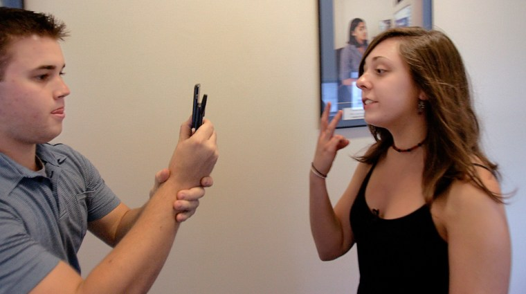 Kendal Stavros, 21, is filmed by Mark DiCristofaro as they make a movie using cellular telephones at the Boston University school of communications, Oct. 12.