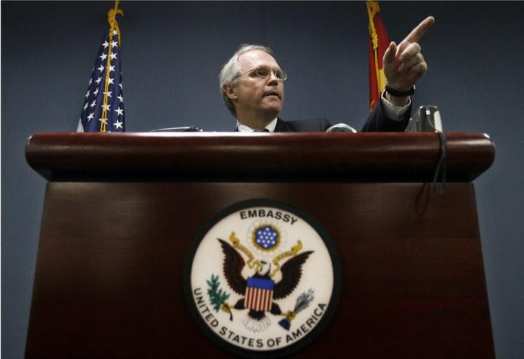 Top US negotiator Christopher Hill gestu