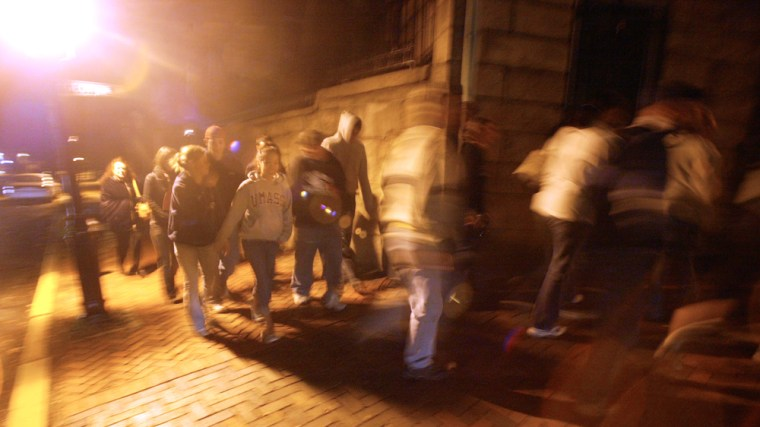 A group on a ghost tour walks the historic east side of Providence, R.I. earlier this month.