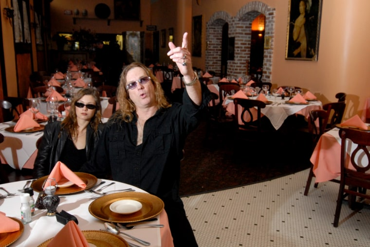 Amy Scozzeri and Dash Bearsley, of Ghost Tours of Galveston, pose at a restaurant in Galveston, Texas, they claim is haunted. The two have taken thousands of tourists for a two-hour walking tour of the Strand District's spookiest places.