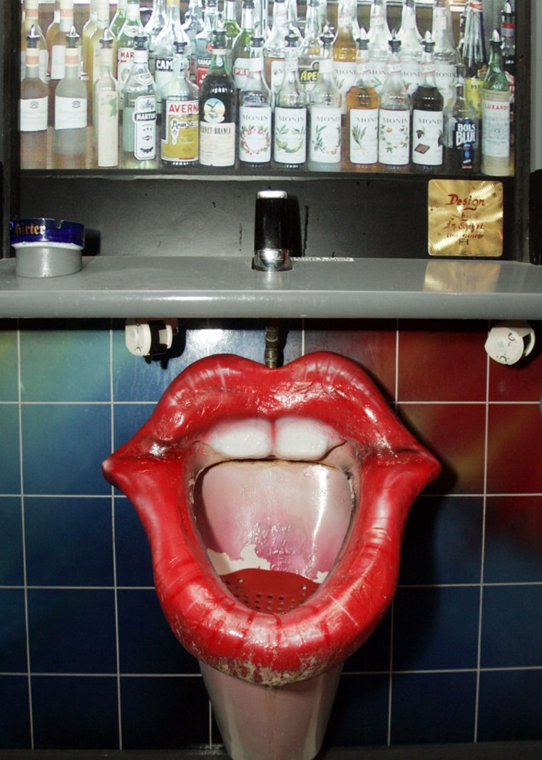 A urinal shaped like the mouth of a woman is seen at a public toilet in Vienna, Austria,on Oct. 19. Women's groups were outraged by the fixtures, which were removed by their owner and put up for sale on eBay.