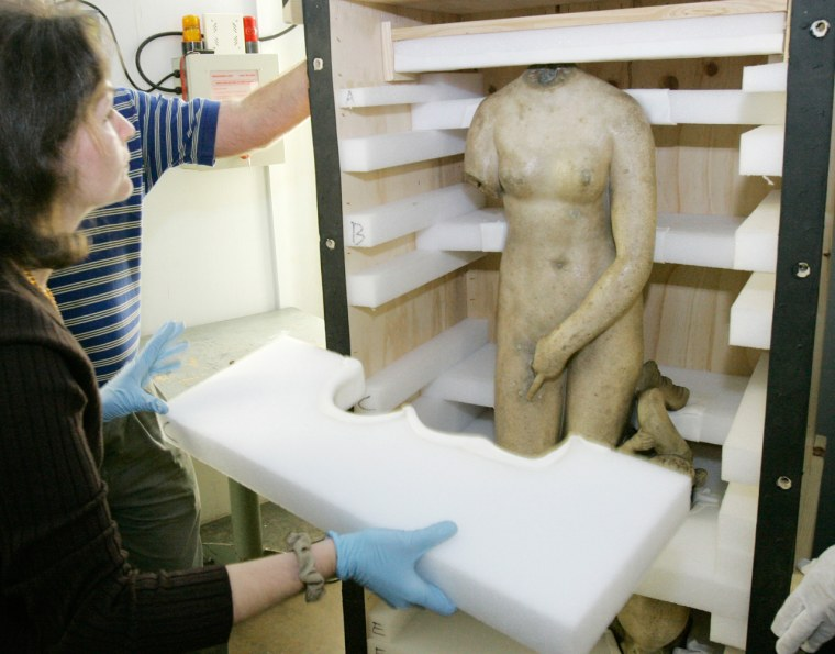 Renee Stein, conservator of the Michael C. Carlos Museum at Emory University, unpacks the body of a Roman marble statue of Venus to be scanned in the X-ray room at Delta Air Lines Technical Operations Center in Atlanta on Thursday.