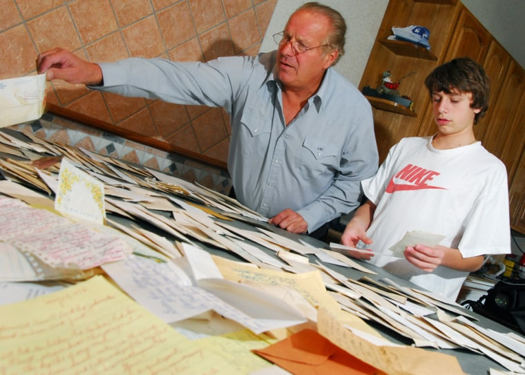 Bill Lacovara and his son Rocky, 16, sort through the letters they found while fishing in Atlantic City, N.J.
