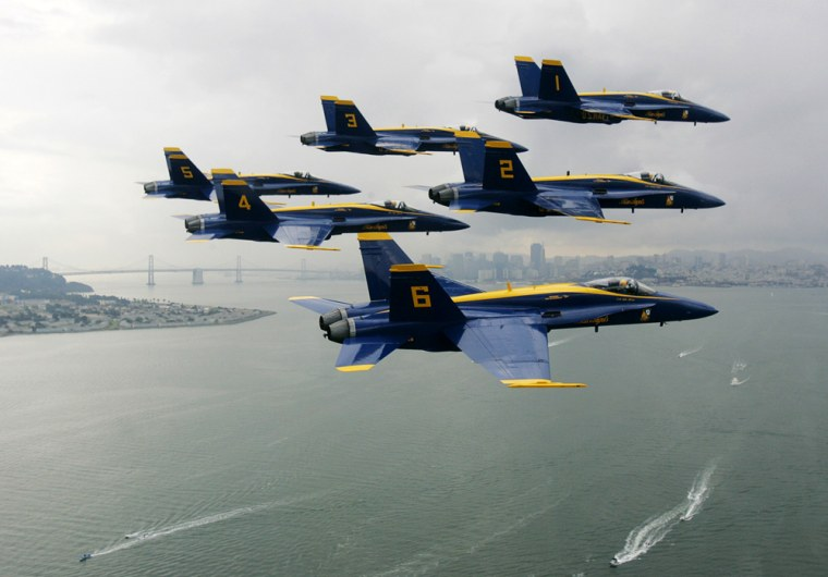 The U.S. Navy's Blue Angels fly in a Delta formation over the bay of San Francisco during a practice run in preparation for Fleet Week air show in California