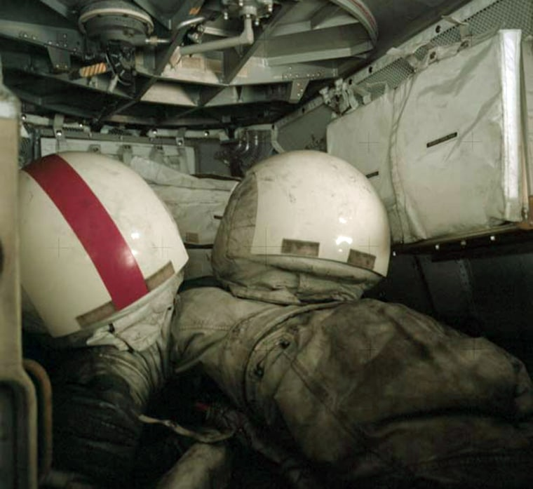 Dusted and dirty helmets and space suits stowed inside Lunar Module after final Apollo 17 moonwalk in December 1972.