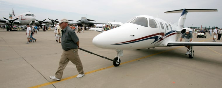 Dave Reed of Eclipse walks the new Eclipse 500 back to its display at the EAA Airventure 2006 in Oshkosh, Wis., on July 28th.