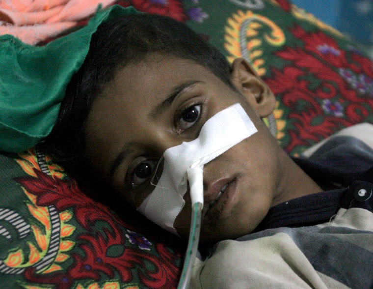 An Iraqi youth, victim of a Wednesday mortar attack, is treated in Sadr City's hospital in Baghdad.