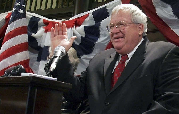 Hastert waves to supporters during a mid term party in St Charles