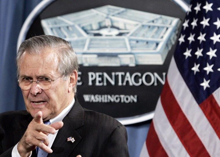 File photo of US Secretary of Defense Rumsfeld taking questions in Washington