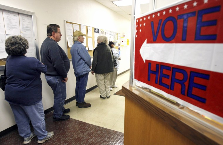 Absentee voters form a line as they wait for ballots at the Licking County Board of Elections in Newark, Ohio
