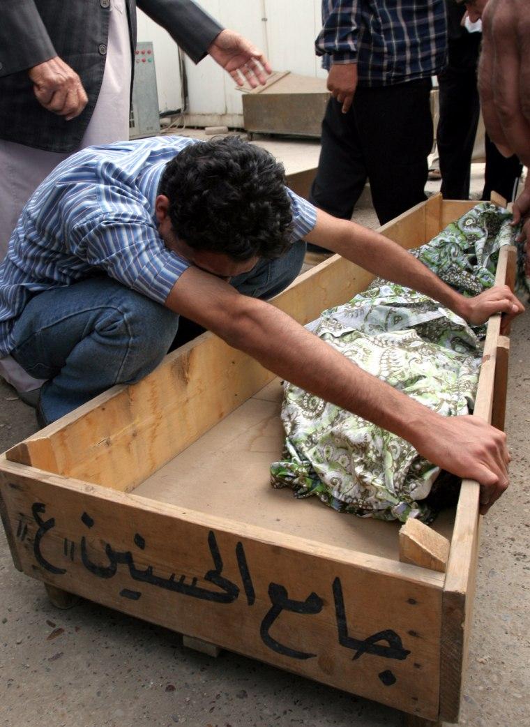 A relative cries over a dead child's body on Wednesdayin al-Sadr hospital in Sadr City, Iraq.