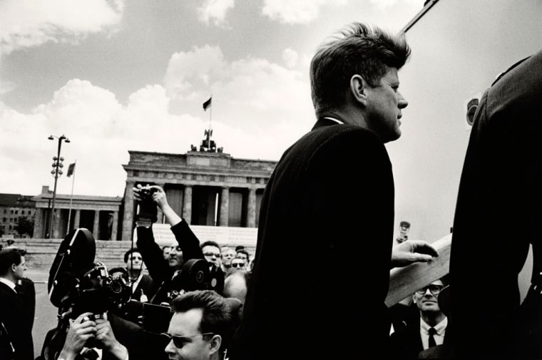 In this photo released by the Kennedy Museum, President John F. Kennedy is seen at the Brandenburg Gate in Berlin, Germany on June 26, 1963.