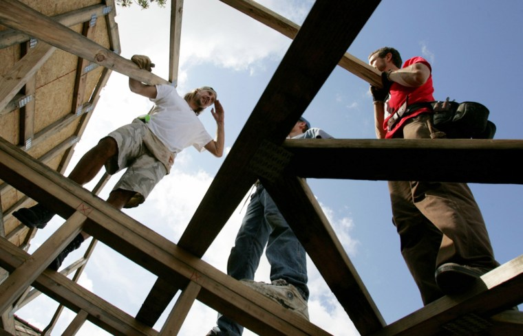 Sonefeld of Hootie and the Blowfish and volunteers work on home in New Orleans