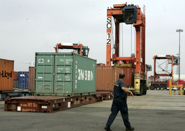 A Customs officer walks past a cargo container testing area in Newark, N.J, in a July file photo. Despite new technological advances, most cargo containers arriving in U.S. ports are not screened, as has been recommended by the Sept. 11 Commission.