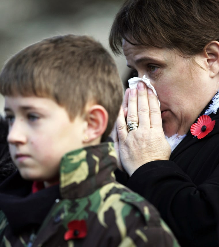 Mother weeps on Armistice Day in Princes Street Gardens in Edinburgh