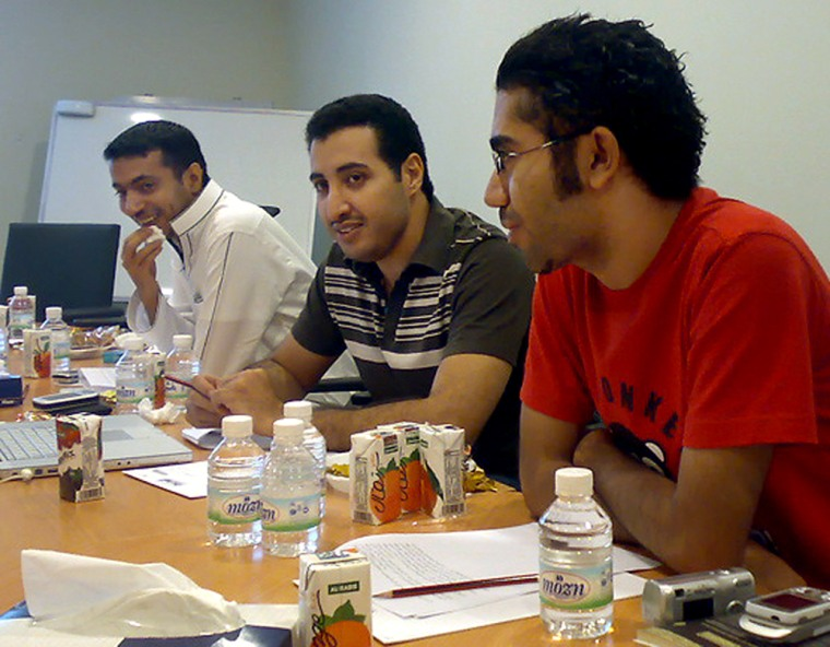 Saudi Arabia's most popular blogger Fouad al-Farhan, center, with Ahmed al-Omran left and Bandar Raffa during a founding meeting of Kingdom of Saudi Arabia Bloggers. The group hopes to do virtually what they can't do physically in Saudi Arabia, create a democratic community of bloggers.