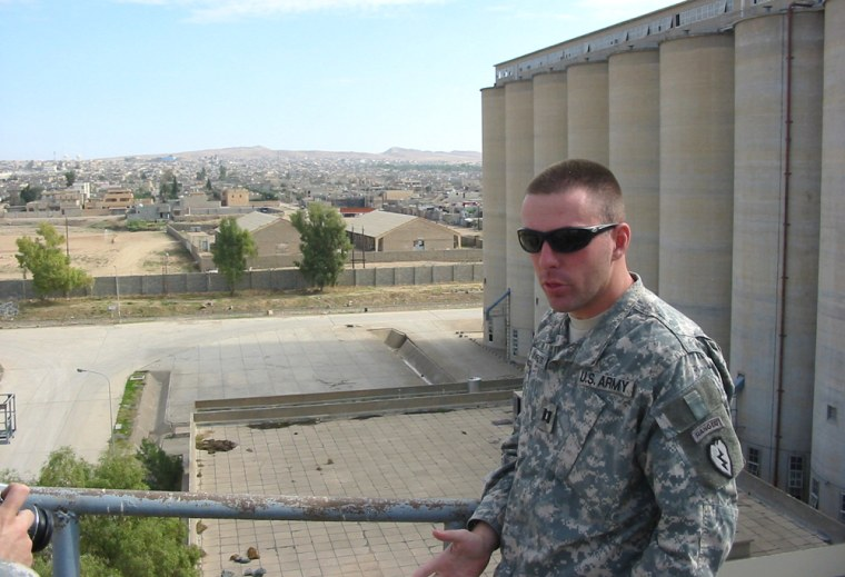 Capt. Mike Lingenfelter, 32, of Panhandle, Texas, stands atop a large granary in Tal Afar, Iraq, on Nov. 3.