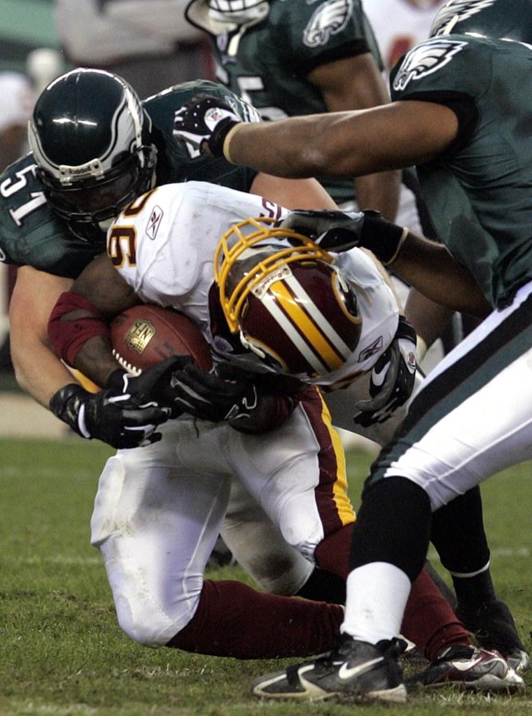 Washington Redskins running back Clinton Portis has his face mask pulled in Philadelphia