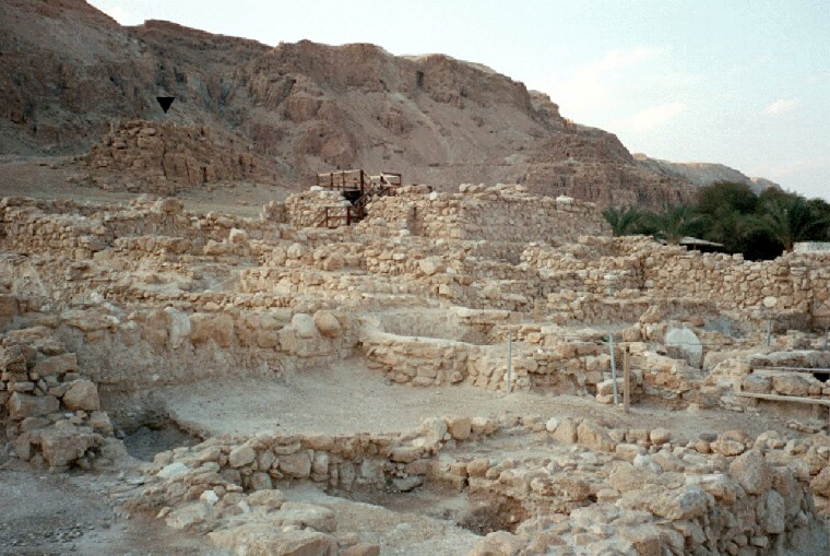 This panorama shows the Qumran site on the northwestern shore of the Dead Sea, on the West Bank. At upper left, a black triangle indicates a bluff, behind which the Qumran community may have designated a latrine.