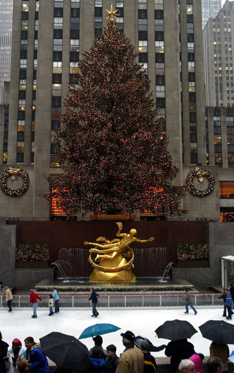 Skaters skate below the Christmas tree decorating Rockefeller Center in New York Dec. 17, 2003.