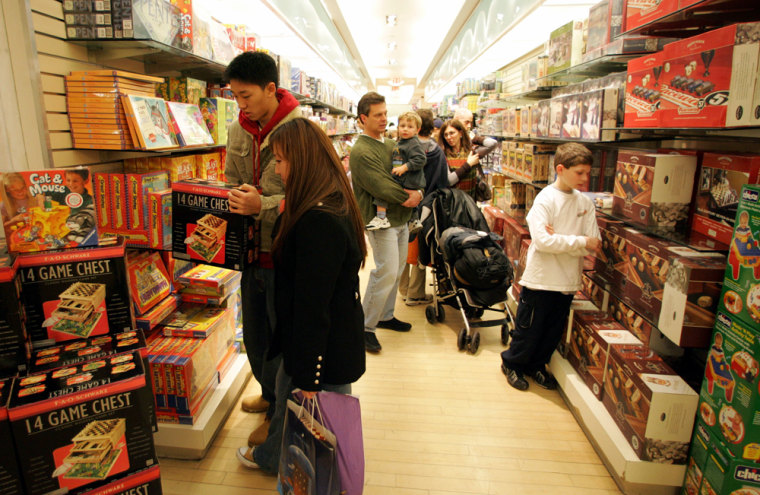 Shoppers check on games displayed at the