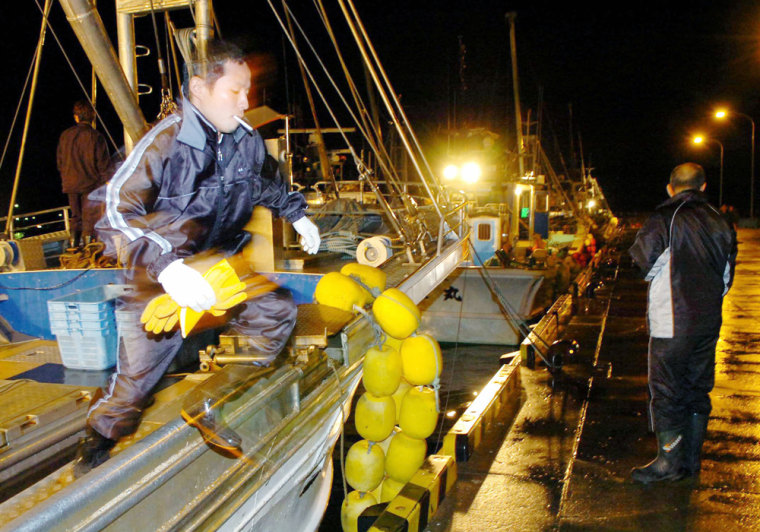 Fishermen prepare to steam out of the port for safety at Esashicho, Hokkaido, northern Japan, on Wednesday night, shortly after a tsunami alert was issued.