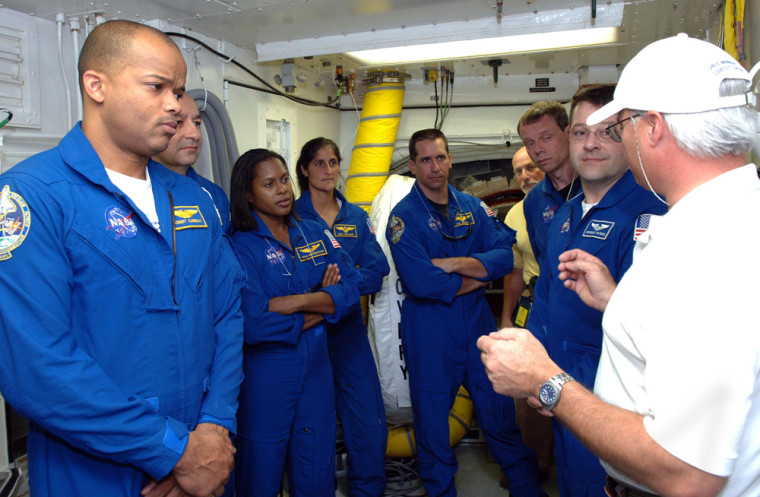In the White Room on Launch Pad 39B, Discovery crew members are told on Wednesday what they can expect on launch day. From left are astronauts Robert Curbeam, Mark Polansky, Joan Higginbotham, Sunita Williams, William Oefelein, Christer Fuglesang and Nicholas Patrick.
