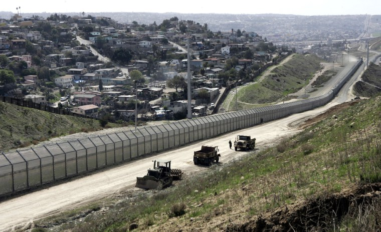 The U.S.-Mexico border fence separating San Diego and Tijuana, Mexico. With the Democrats in control of Congress, Hispanic political activists are preparing for a big push forreform.