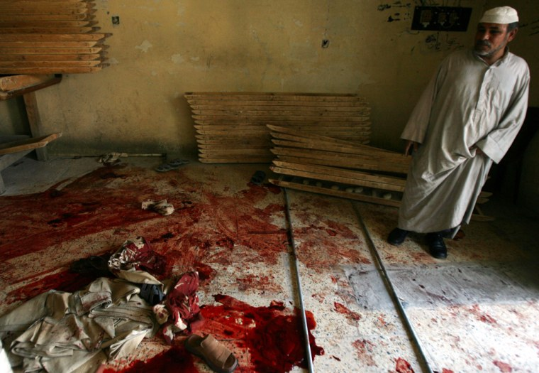 A man inspects a bakery shop following a deadly attack in Baghdad on Thursday.