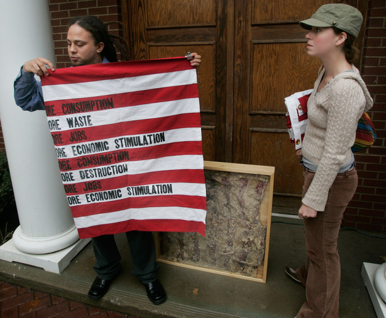 Artists William Gentry, left, and Megan Ellis display one of the U.S. flags and a deep-fried flag that were removed Wednesday in Clarksville Tenn. from an exhibit at the Customs House Museum.