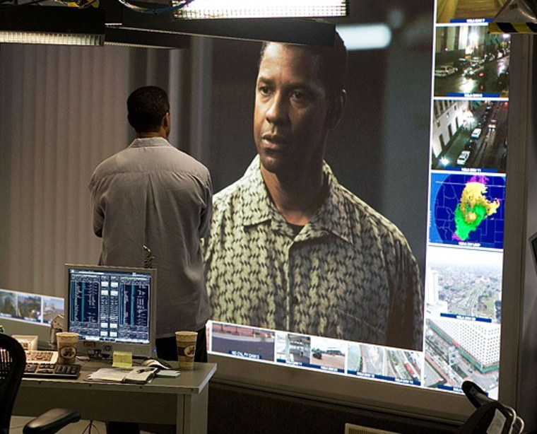 """ATF agent Doug Carlin (Denzel Washington) watches his actions from four and a half days earlier on a giant screen in a scene from the time-travel film """"Deja Vu."""""""
