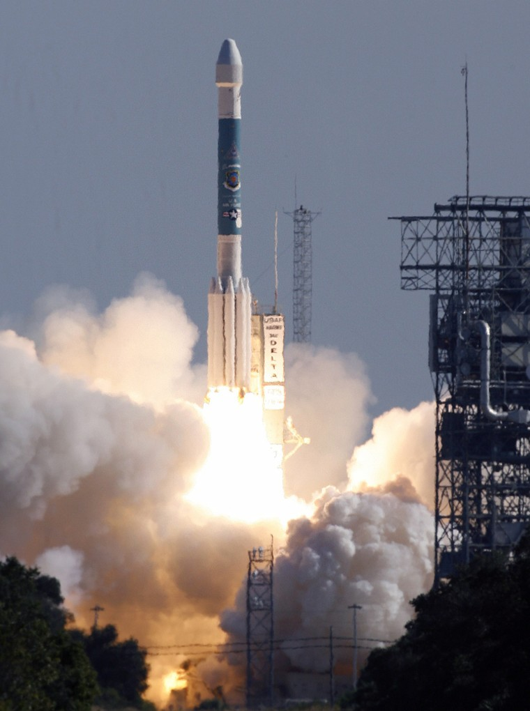 A Boeing Delta II rocket with a NAVSTAR  Global Positioning System satellite aboard blasts off