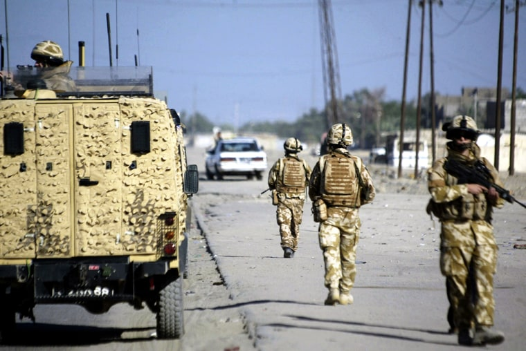 British soldiers patrol a street in the