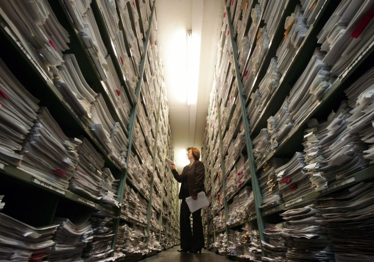 Spokeswoman Maria Raabe is seen in the correspondence archive at the International Tracing Service in Bad Arolsen, Germany, on Nov. 9. This vast archive — 16 miles of files in six nondescript buildings in the German spa town — contains the fullest records of Nazi persecutions in existence.