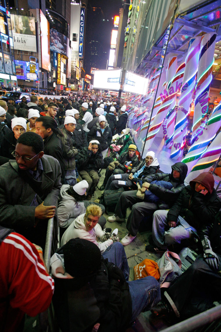 Customers line up outside of Toys R Us in Times Square, in New York City Saturday, Nov. 18, 2006. Fans hoped to be among the first to buy Nintendos new Wii video game system.