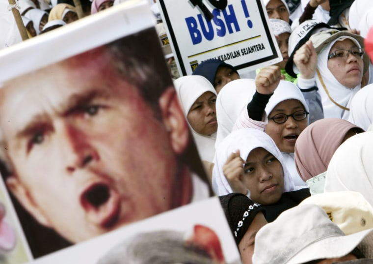 Women in Bogor, Indonesia, protest President Bush's visit on Monday.