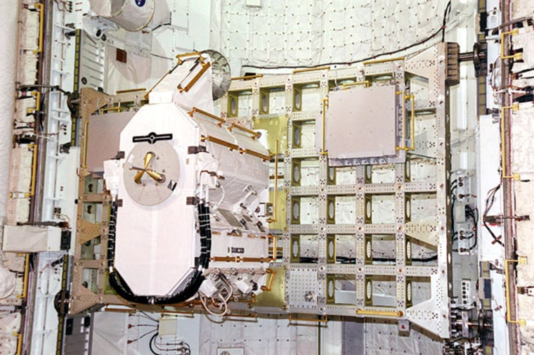 The Early Ammonia Servicer, a piece of equipment that weighs as much as a heavy grand piano, sits on a rack inside a shuttle cargo bay. The EAS was delivered to the international space station aboard the shuttle Discovery in 2001, and will soon be jettisoned into space.