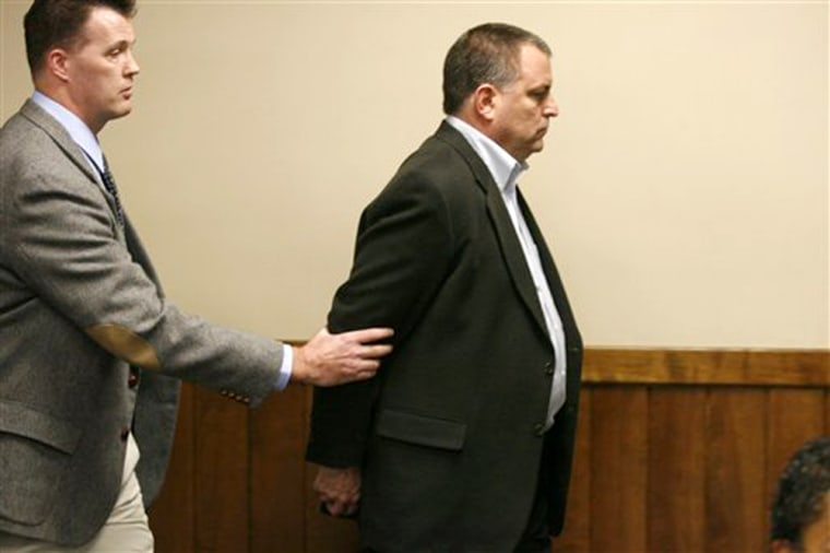 Former GOP fundraiser Tom Noe is escorted out of the courtroom in Toledo, Ohio, after being convicted of stealing from a state investment in rare coins, in this Nov. 13 photo.
