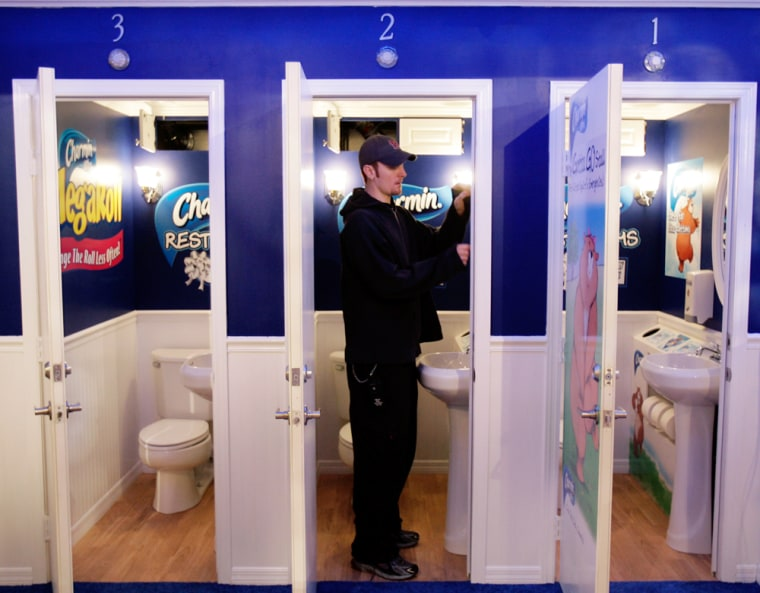 Neil Rinden prepares the bathroom stalls set to open Monday in New York's Times Square. Toilet paper company Charmin has built the public restrooms available for free at a formerly-empty warehouse in the middle of one of the busiest intersections in the world.