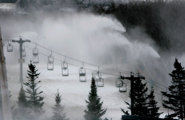 Snow guns pump out man-made snow at Bretton Woods Ski area in Bretton Woods, N.H., on Monday. Temperatures in New England have finally dipped below freezing as ski areas make snow in hopes of opening Thanksgiving weekend.