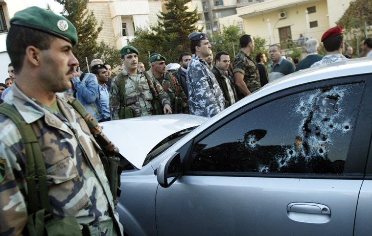 Lebanese security forces surround the bu