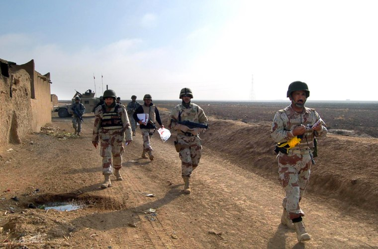 Iraqi army soldiers patrol an area in th
